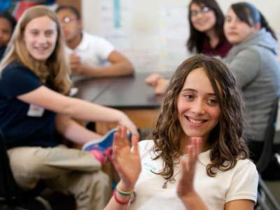 Students applauding and having fun during a lesson